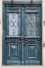 Closed Old Wooden Door with wrought iron door grille