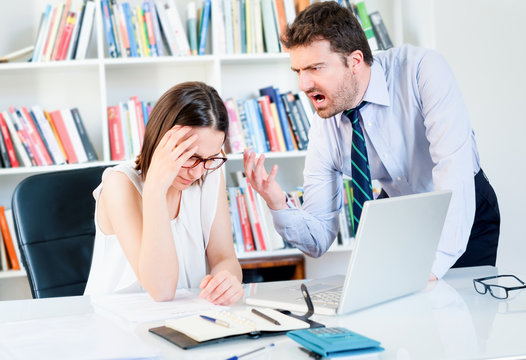 Young woman harassed by boss at office workplace