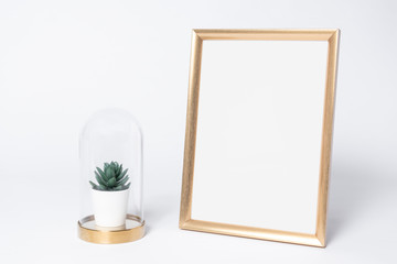 golden photo frame mock up and cactus Interior decor home elements.