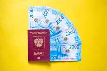 russian passport and russian money on yellow background