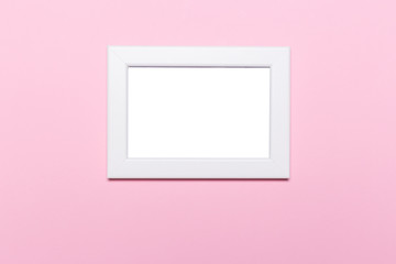 blank frame on a pastel pink background