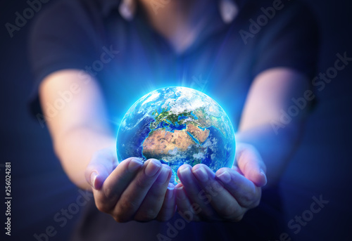 Wall mural Hands Holding Planet  - Earth Day Concept - 3d Rendering - Europe And Africa elements of this image furnished by NASA