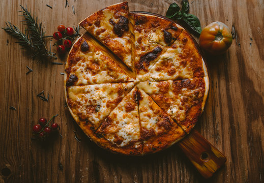 flat-lay photography of pizza on brown wooden pizza pan