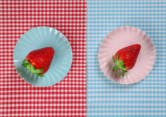 strawberries on a blue and red background