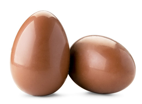 Two chocolate eggs on a white background. Isolated.