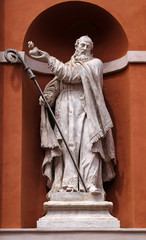Saint Barnabas statue on the portal of St. Barbabas Church, Italy