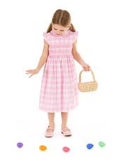 Easter: Little Girl Looks Down At Easter Eggs