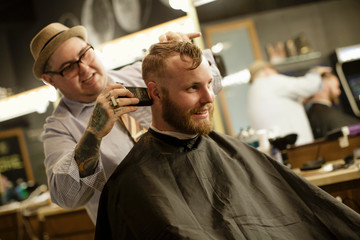 Barber shaves back of client's head
