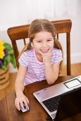 Computer: Smiling Girl Uses Computer Mouse