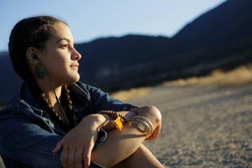 Young woman wears headphones