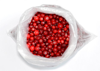 Wild cranberries in a package on a white background