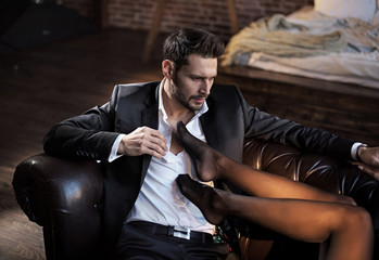 Foto op Plexiglas Artist KB Handsome businessman relaxing in the luxurious apartment with a sensual woman
