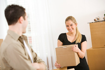 Moving: Woman Carrying Box During Move