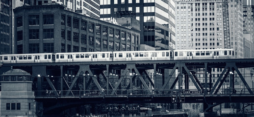 Black and white view of elevated railway train in Chicago,