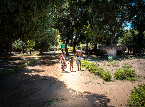African family with a little kid walking around the village. Nosy-be, madagascar (africa)