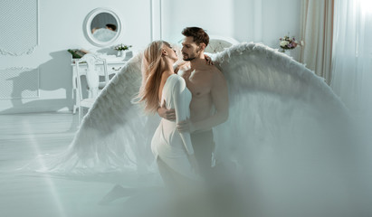 Foto op Plexiglas Artist KB Conceptual portrait of an archangel embracing a beautiful woman