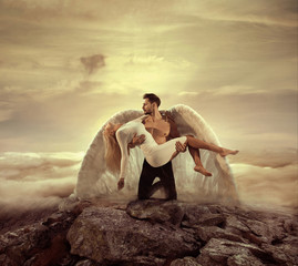 Portrait of an archangel carrying a beautiful innocent woman