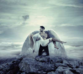 Keuken foto achterwand Artist KB Handsome archangel carrying an innocent, unconscious lady