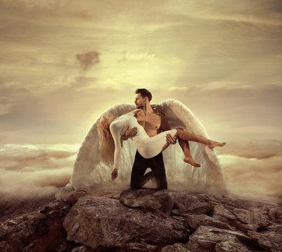 Portrait of an archangel carrying a beautiful innocent woman