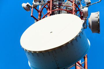Upward view of Communication Radio antenna Tower , microwave antenna tower on blue sky background