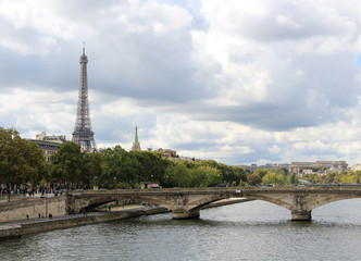Dramatic sky over the Seine in Paris, France. View of the Eiffel Tower and Jena Bridge.