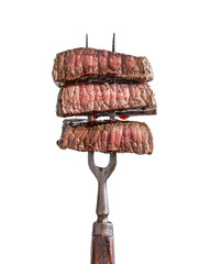 Wall Murals Steakhouse Slices of beef steak on vintage fork isolated on white