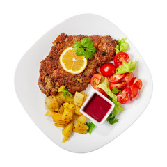 Viennese schnitzel with salad top view with copy space