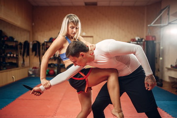 Female person practicing knee kick to the stomach
