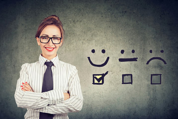 Confident happy business woman received excellent rating for a satisfaction survey
