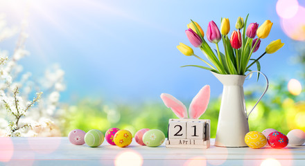 Easter - Calendar Date With Decorated Eggs And Tulips In Sunny Garden