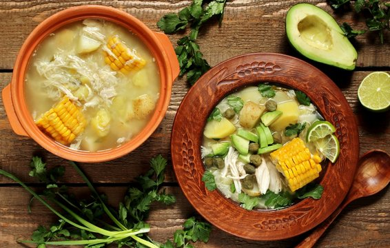 "chicken soup with potatoes. Colombian cuisine. in spanish it sounds like ""Ajiaco"".  Latin American cuisine. served with avocado, capers, lime, cilantro. saturated rich homemade soup."