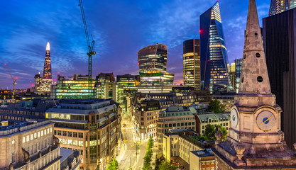 Aerial view of skyscrapers of the world famous bank district of central London after dusk, street view
