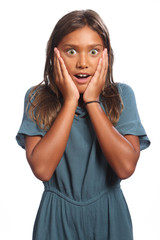 Young mixed race school girl surprised expression