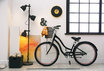Stylish room interior with modern bicycle. Hipster design