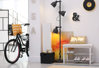 Stylish hallway interior with modern bicycle. Hipster design