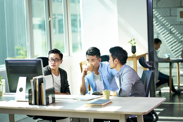 three asian business men working together in office