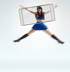 Attractive young female dancer wearing police uniform. conceptual image with a smartphone, demonstration of device capabilities