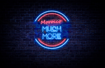 A red and blue neon light sign that reads: Morocco Much More