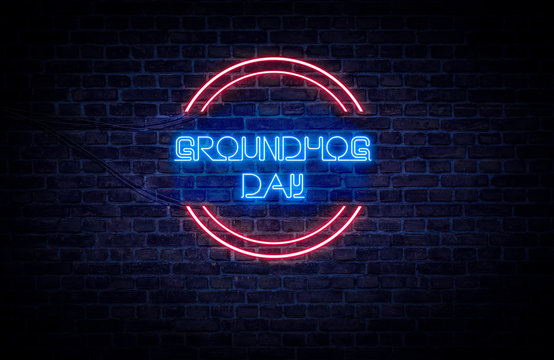 A red and blue neon light sign that reads: Groundhog Day