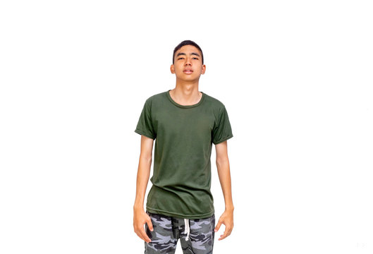 Young Thai man in short hair style with olive green shirt stands showing his  bored face
