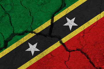 Saint Kitts and Nevis flag on the cracked earth