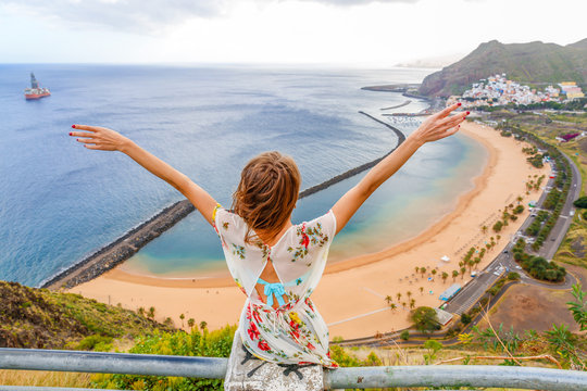 Traveler girl enjoying the beach in Tenerife