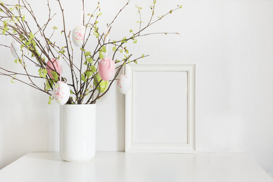 Easter. Vase with birch tree branches with Easter eggs and frame.