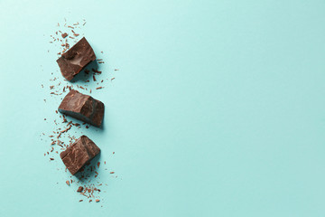 Sweet tasty chocolate on color background