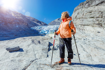 Best Norway hike. Senior women with hiking equipment in the mountains