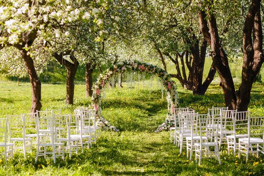empty area for wedding registration in the spring garden. wedding ceremony for the bride and groom in the blooming garden