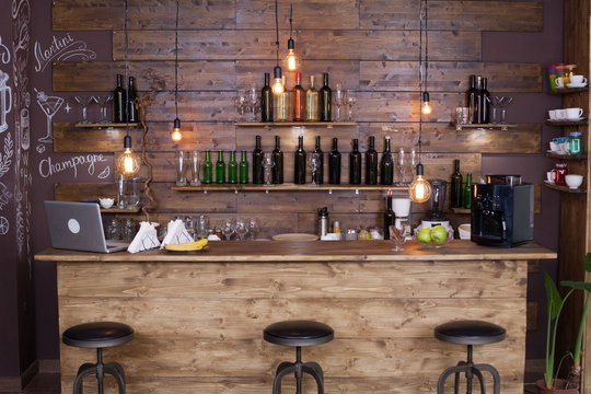 Coffee shop bar counter with wine bottles
