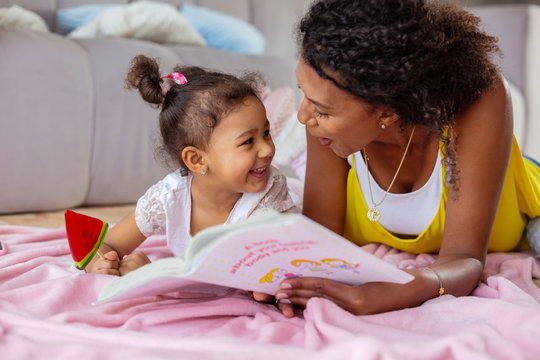 Cheerful young mother communicating with her daughter
