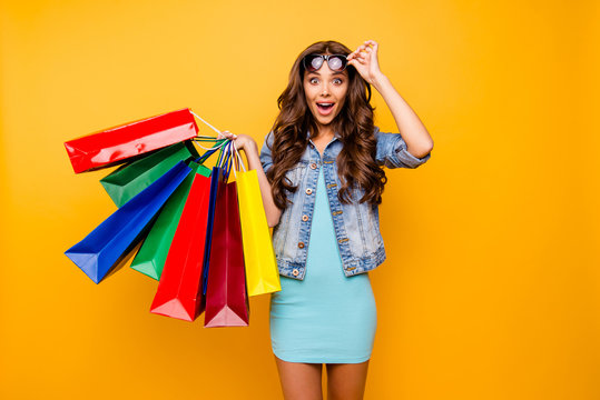 Close up photo beautiful her she lady yell scream shout new staff shopping spree excited big choice choose wear specs blue teal green short dress jeans denim jacket clothes isolated yellow background