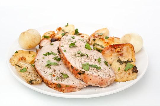 Sliced Boneless Pork Loin Roast on a plate with potato